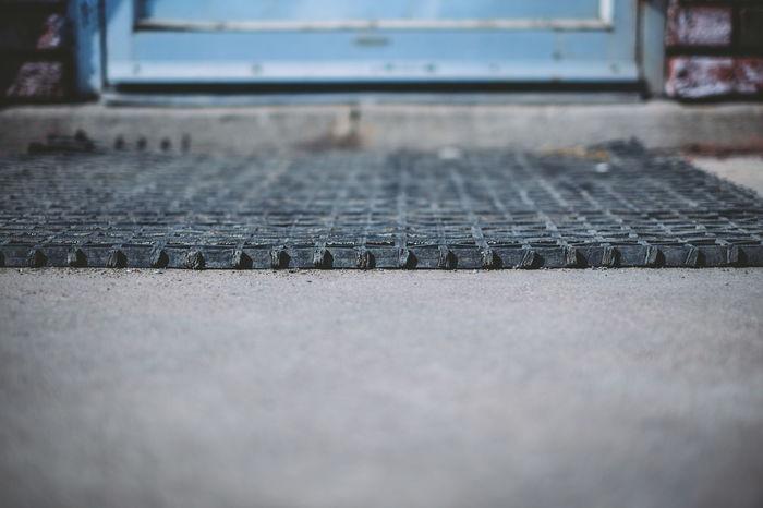 Asphalt Diminishing Perspective Door Floor Mat Focus On Foreground Low Angle View Outdoors Selective Focus Street Surface Level Textured
