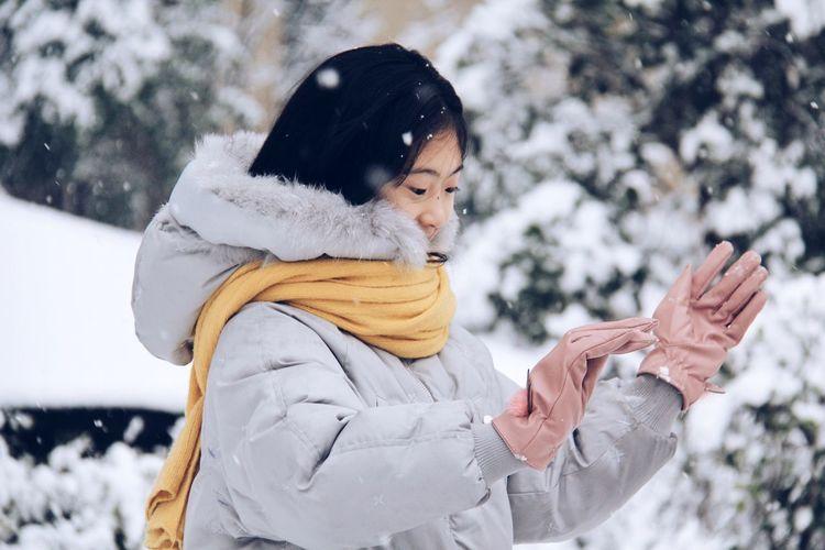 Woman Enjoying Snowfall
