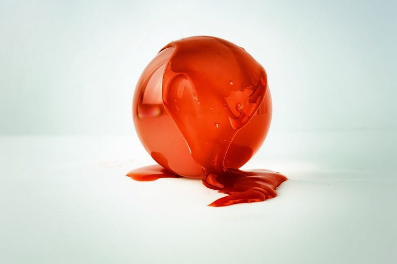 total symbiosis Simplicity Purity Minimal White Background Still Life Studio Shot Red Circle Sphere Ball Reflections Liquid Viscous Movement Oozing Colour Single Object Close-up Glass Ball Crystal Balls Capture Tomorrow