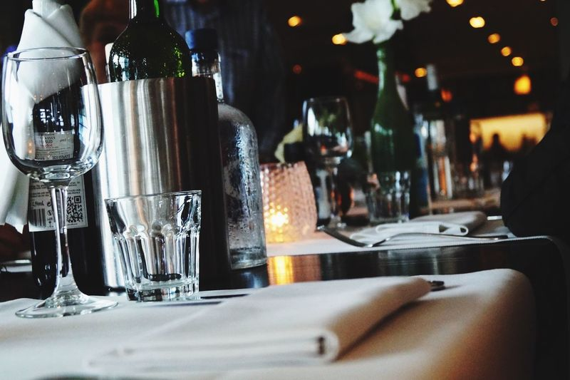 Empty wineglass and drinking glass on restaurant table