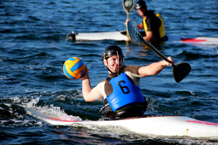 Action Adventure Aquatic Sport Competition Day Holding Inflatable  Kayak Kayak Sports Leisure Activity Lifestyles Men Motion Nature Nautical Vessel Outdoors People Real People Safety Sea Sport Sports Equipment Summer Sports Water Water Polo