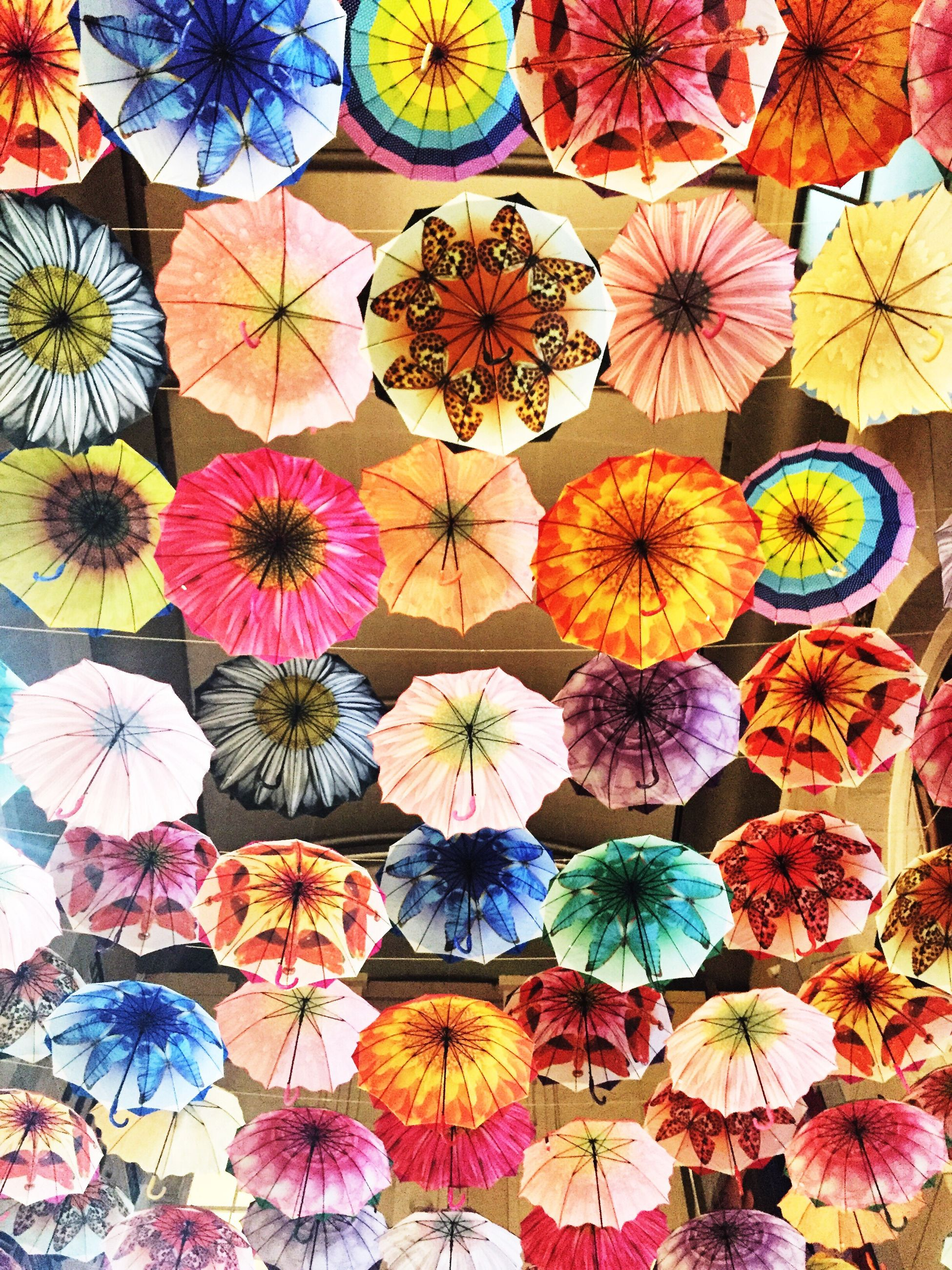 multi colored, full frame, indoors, backgrounds, pattern, floral pattern, variation, art and craft, decoration, colorful, design, abundance, creativity, art, large group of objects, high angle view, arrangement, choice, no people, ceiling