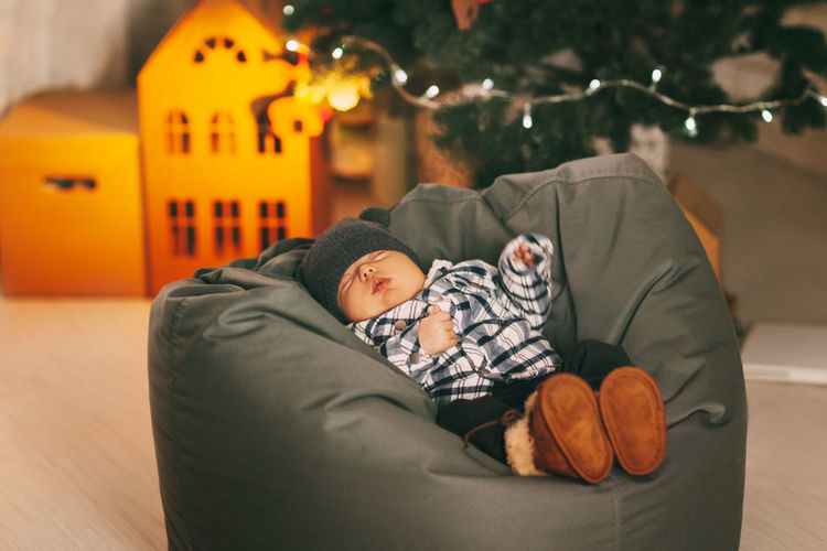 Rear view of boy sleeping at home