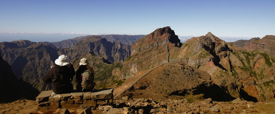 hiker and mountain panorama, madeira, portugal Mountain Sky Mountain Range Beauty In Nature Real People Nature Landscape Tranquil Scene Rear View Lifestyles Outdoors Madeira Madeira Island Madeira Islands, Portugal Hiker Hiking Hiking Adventure Backpacker Couple Resting Panoramic View Mountain View People Watching Exploring Traveling