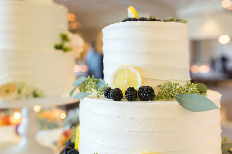 Close-Up Of Wedding Cake On Stand At Table