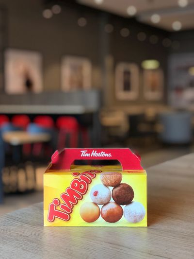 Tim Hortons Timbits Tim Hortons  Focus On Foreground Table Indoors  Close-up Red No People Communication Text Emotion Love Celebration Paper Positive Emotion Multi Colored Group Of Objects Food And Drink Heart Shape Still Life Stack