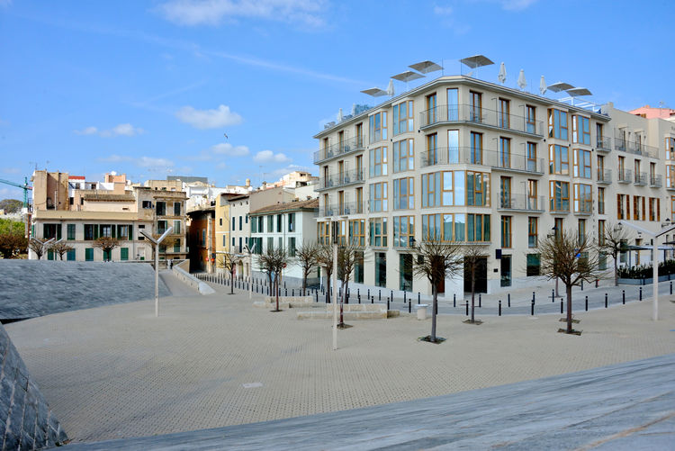 exterior building of modern hotel with terrace and beach umbrellas on the roof top Building Exterior Built Structure Architecture City Building Street Residential District Outdoors Travel Destinations Sunlight No People Palma De Mallorca Hotel View Streetphotography Architecture Day