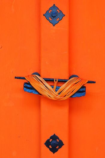 EyeEm Selects Orange Color No People Red Built Structure Day Outdoors Architecture Detail Shinto Shrine Door Hardware Japan Photography Close-up