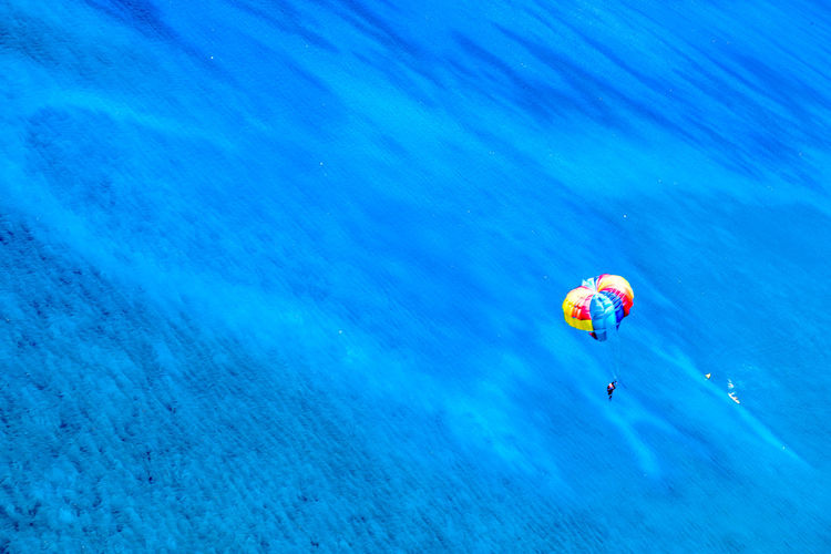 High Angle View Of Person Parasailing Over Sea