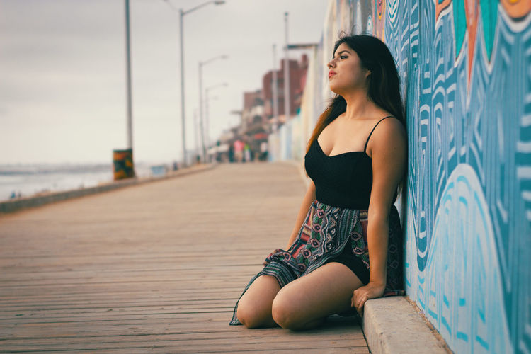 Beach Beauty Casual Clothing Day Focus On Foreground Leaning Leisure Activity Lifestyles Long Hair Malecon Outdoors Portrait Promenade