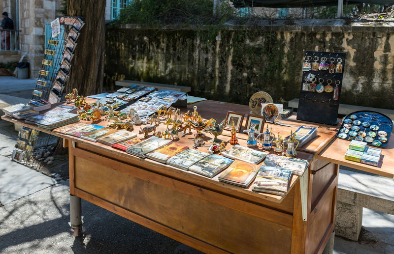 Jerusalem, Israel, March 09, 2019 : Souvenir shop for tourists in the courtyard of Pools of Bethesda in the old city of Jerusalem, Israel Tank Roman Cistern Heritage Historic Brick Wall Stone Material Damaged Arch Remains Landmark Ruins Christianity Excavations Scenic View Ancient Archaeological Religion And Beliefs Culture Antique Architecture Jerusalem Israel Old City Church Of Saint Anne And The Pools Of Bethesda Worship