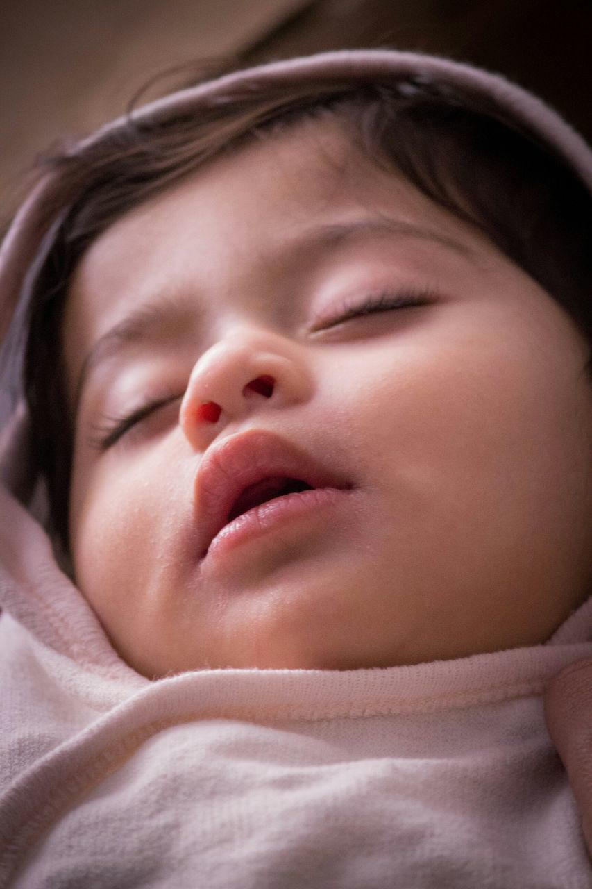 eyes closed, sleeping, indoors, real people, innocence, babyhood, cute, baby, close-up, one person, childhood, headshot, bed, human face, new life, newborn, fragility, day, people