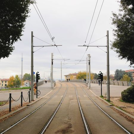 Cable Transportation Railroad Track Power Line  The Way Forward Rail Transportation Tree Electricity Pylon Connection Day Railway Track Sky Mode Of Transport Public Transportation Electricity  Outdoors Real People Men Telephone Line Nature