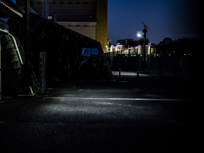 Illuminated buildings along street at night