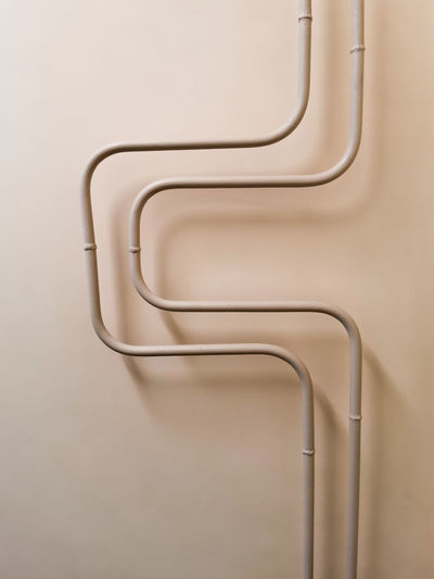 Close-up of pipes against white background