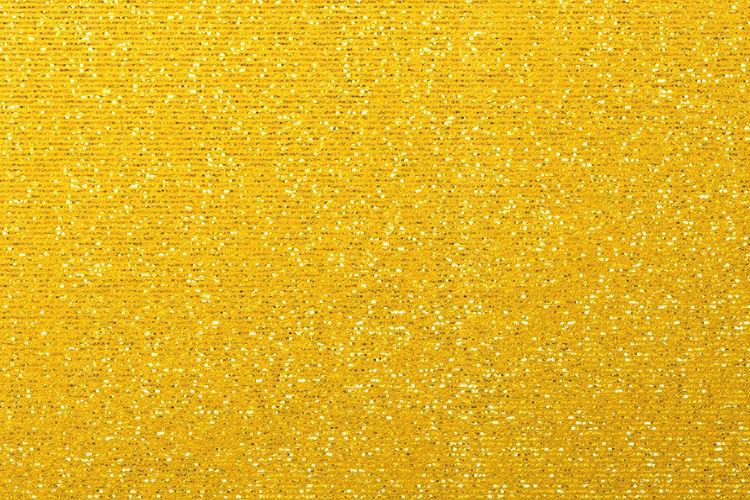 Full frame shot of yellow shiny decoration