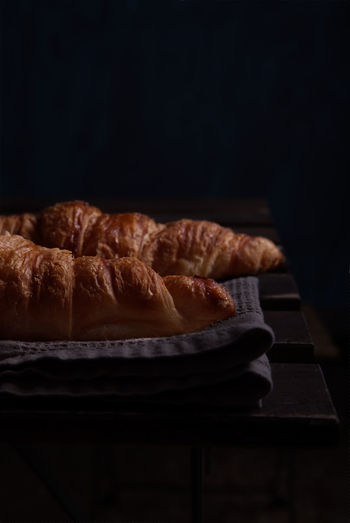 Close-up of breakfast on table against black background