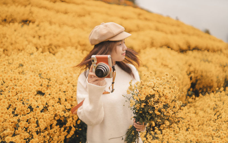 Woman photographing camera