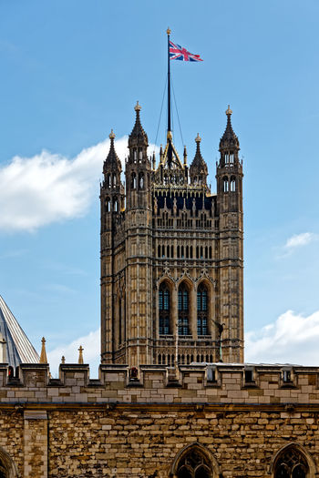 Low angle view of westminster abbey against blue sky