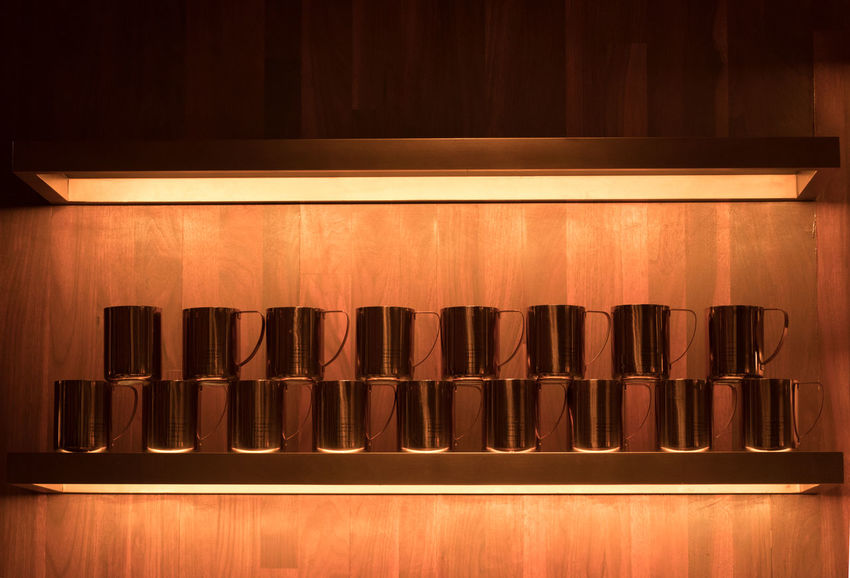 Indoors  No People Side By Side In A Row Wood - Material Arrangement Large Group Of Objects Food And Drink Shelf Still Life Illuminated Communication Order Empty Household Equipment Bar - Drink Establishment Container Brown Starbucks Coffee Starbucks Reserve Roastery Shanghai Coffee Cup Display
