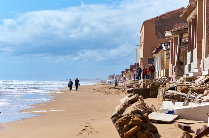 Damaged beach houses. The wind and waves is washed away the beach houses on the Babilonia beach. Guardamar del Segura. Province of Alicante. Spain 2017 Alicante Province Spain Architecture Babilonia Beach Beach Houses  Blue Sky Brick Broken Coast Coastline Costa Blanca Damaged Guardamar Del Segura  Mediterranean Sea Natural Disaster Residential Building Rubble Ruin Ruined Buildings Sea Shoreline SPAIN Storm Sunny Day Waterfront