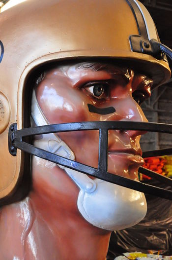 Inside the Mardi Gras Museum - New Orleans, USA New Orleans EyeEm American Football Player Chin Protector Close-up Day Face Protector Headwear Helmet Looking At Camera Mardi Gras Museum One Person Orange Helmet Outdoors Portrait Real People Staring Eyes Young Adult Capture Tomorrow