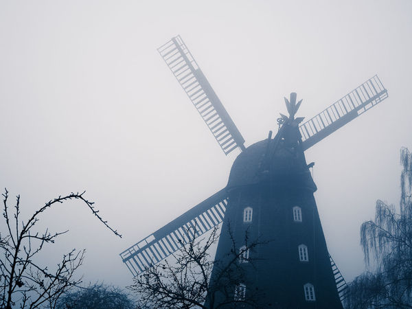 Jeans Brown Photography - windmill Architecture City Day Fog Foggy Foggy Day Foggy Morning Foggy Weather Low Angle View No People Outdoors Sculpture Silhouette Skyscraper Statue Sword Windmill Windmill Of The Day