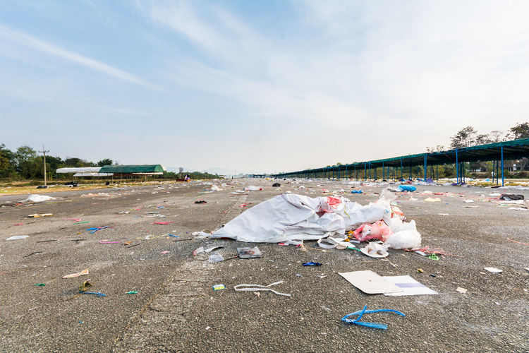 Garbage At Parking Lot Against Sky