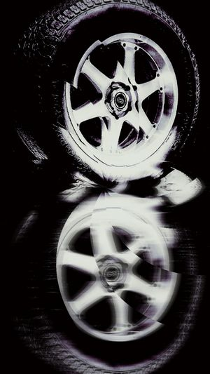 Trying something different for The OO Mission . Tires Wheels Reflection Reflected  Blurred Duplicate Tire Wheel Rims Hubcaps Surreal Surrealism Goodyear Blur Car Parts Round Effects And Filters Effect Cracked Abstract Experimental Mirrored Mirror Image Blurry