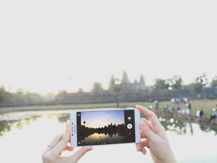 Photography Themes Photographing Portable Information Device Smart Phone Human Hand Wireless Technology Photo Messaging Human Body Part Holding Communication Mobile Phone Technology Adults Only People Only Women Adult Day Device Screen Liquid-crystal Display One Person