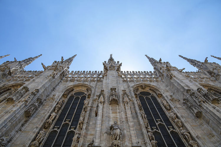 Low angle side view of Duomo di Milano or Milan Cathedral Low Angle View Architecture Sky Built Structure Building Exterior The Past History Travel Destinations Duomo Di Milano Milan Cathedral Place Of Worship Spirituality Building No People Day Travel Tourism Religion Gothic Style Architectural Column Cathedral Gothic Copy Space Religious Architecture Place Of Worship