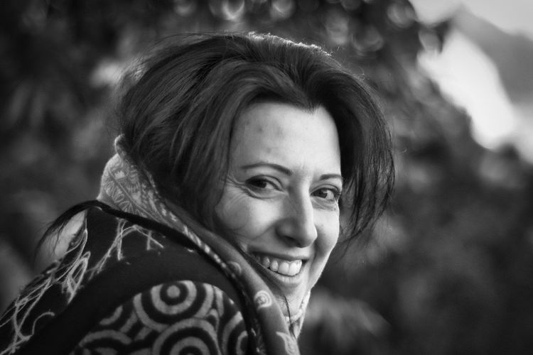 Smiling Bokeh Black And White Blackandwhite Bnw Takumar Fujifilm_xseries Fujifilm Italia Calabria (Italy) Calabria Focus On Foreground Real People One Person Headshot Smiling Outdoors Portrait Looking At Camera Happiness Young Women Day Beautiful Woman People