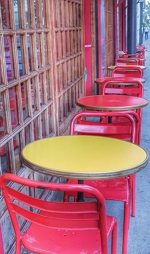 Multi Colored Chair Red Yellow Color Day Scenics The Street Photographer - 2017 EyeEm Awards Streetphotography Samsung Galaxy S7 Edge City Life Life Style From My Point Of View Capture The Moment Ordinary Scene Simple Moment Simple Things In Life Table Simple Photography Paint The Town Yellow