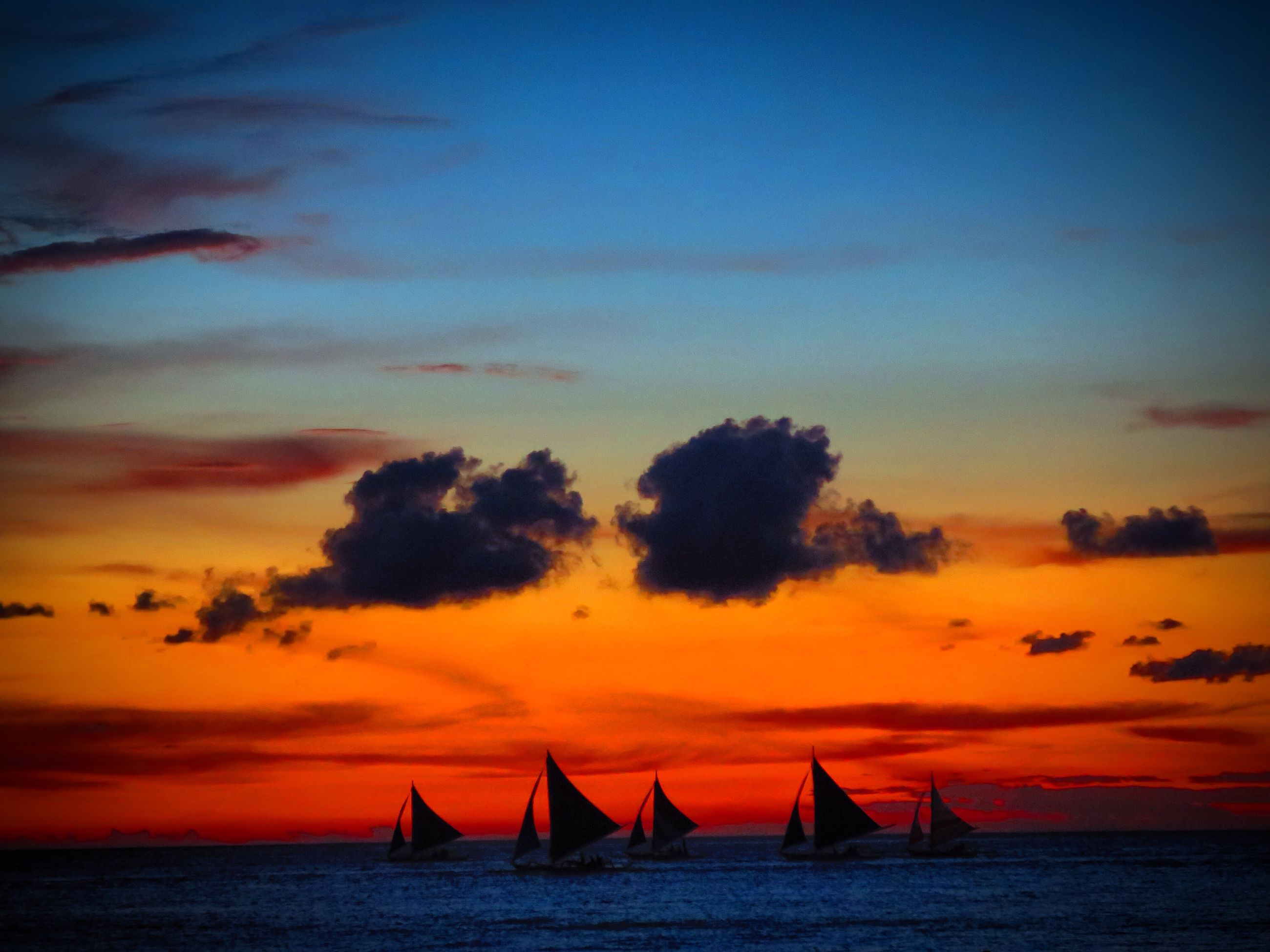sunset, sea, water, orange color, waterfront, nautical vessel, scenics, boat, tranquility, beauty in nature, tranquil scene, sky, transportation, horizon over water, mode of transport, idyllic, nature, silhouette, sailboat, outdoors