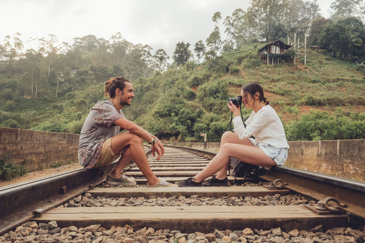 Men sitting on railroad track