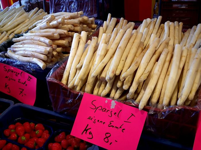 High angle view of white asparagus for sale at vegetable market