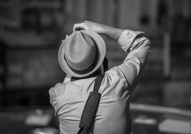 Photographer in action, San Francisco black and white Camera Daytime San Francisco Sunny Tourist Black And White Blackandwhite Bnw Focus On Foreground Hat Lifestyles One Person Outdoors People Photographer Real People Rear View Standing