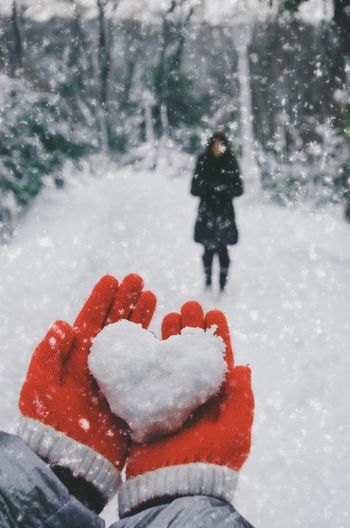 Close-up of person holding snow