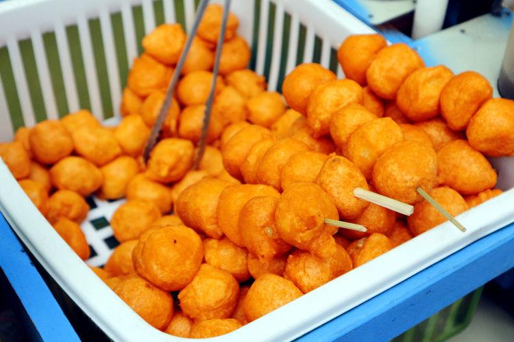 Photo of filipino street food called kwek kwek or deep fried quail eggs