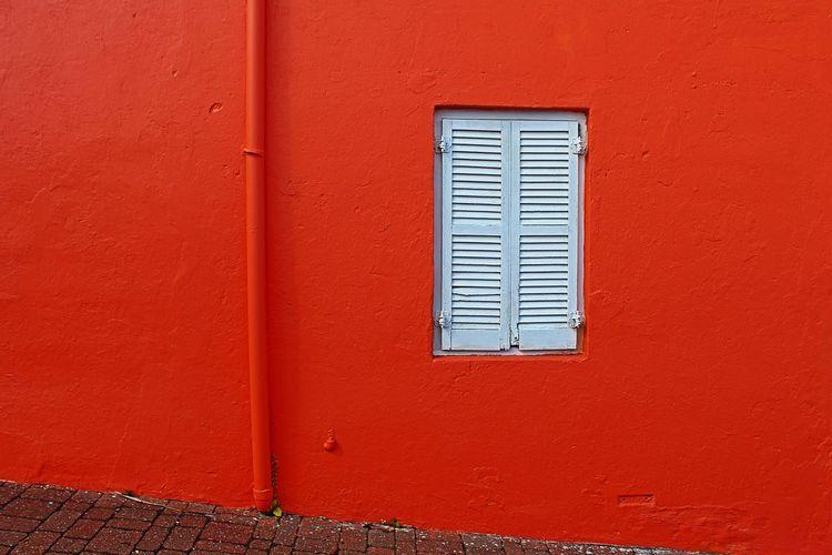 Orange Dreams Orange Orange Color Orange Building Orange Texture Architecture Closed Window Built Structure No People Day Door Building Exterior Outdoors Red Full Frame Close-up