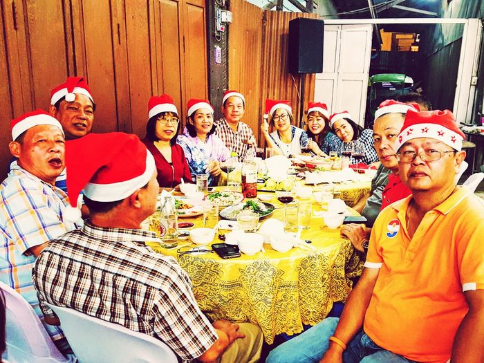 Christmas party and meeting Smiling Happiness Portrait Men Cheerful Friendship Women Looking At Camera Celebration Arts Culture And Entertainment