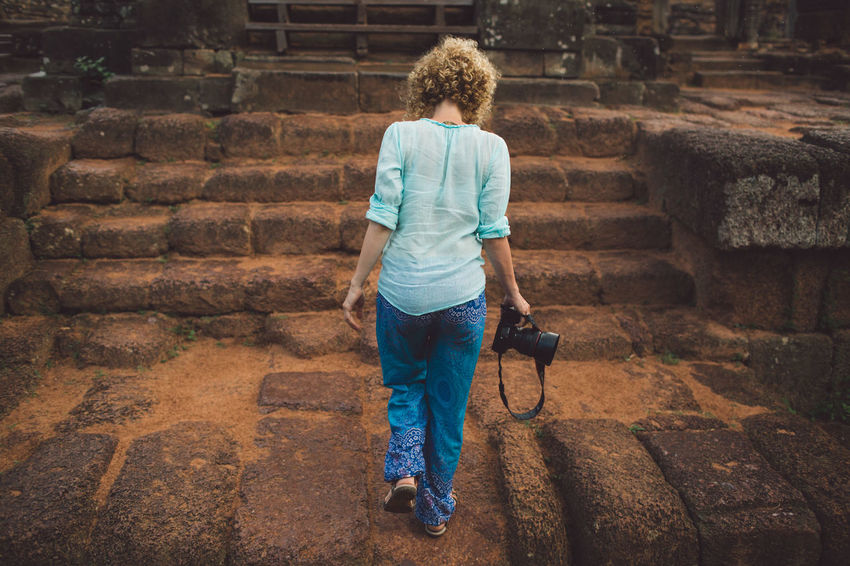 Siem Reap Cambodia Angkor Curly Hair Girl Full Length One Person Architecture Casual Clothing Real People Built Structure Child Lifestyles Rear View Staircase Childhood Males  Walking Wall Day Leisure Activity Men Boys Wall - Building Feature Outdoors Brick Hairstyle Stone Wall