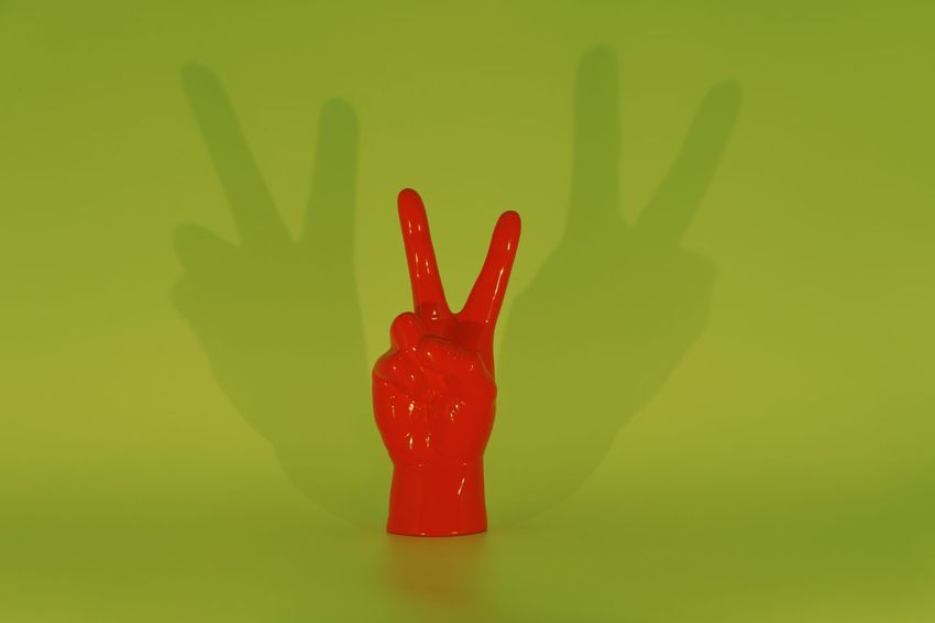 Peace Caption Color Studio Still Life Peace Sign  Peace Red Green Color Close-up Indoors  Hand