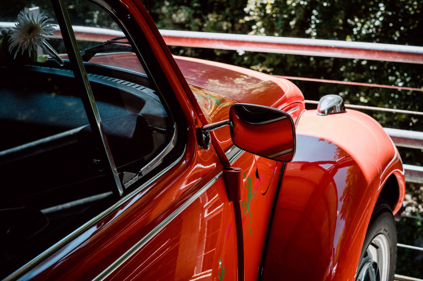Red VW Beetle Car Close-up Day Focus On Foreground Glass - Material Land Vehicle Metal Mode Of Transportation Motor Vehicle Nature No People Outdoors Red Red Color Reflection Retro Styled Stationary Steering Wheel Transportation Vintage Car Wheel