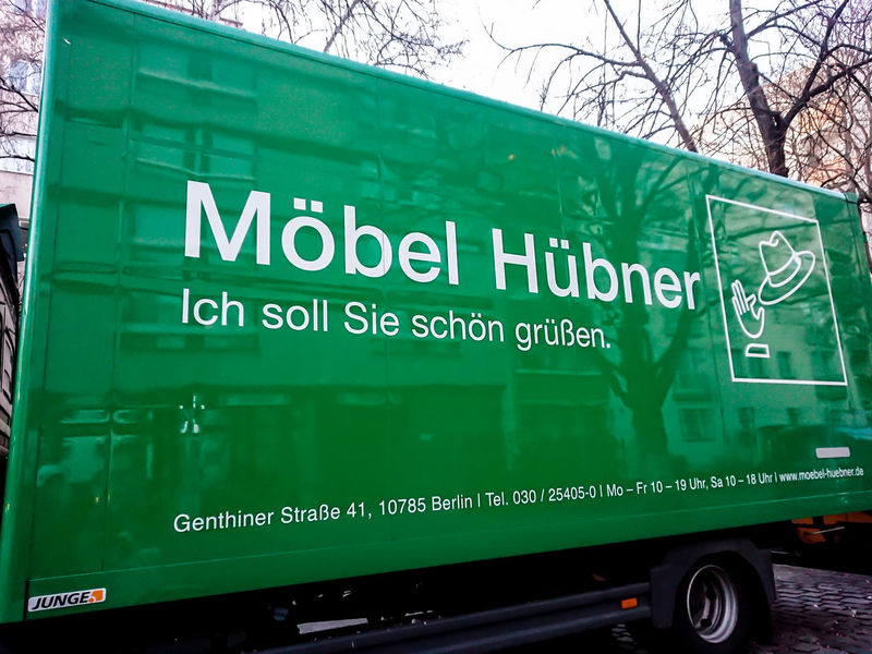 Green delivery van of the German furniture company Möbel Hübner No People Day Text Transportation Mode Of Transportation Land Vehicle Western Script Container Outdoors Freight Transportation Business Sign Van Delivery Van Delivery Truck Green Color Communication