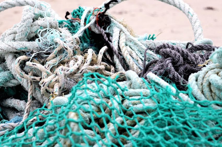 Scotland Fishing EyeEm Selects Fishing Net Close-up No People Rope Commercial Fishing Net Day Fishing Fishing Industry Full Frame Backgrounds Turquoise Colored Still Life Blue Pattern Complexity Selective Focus Tangled Nature Outdoors Strength