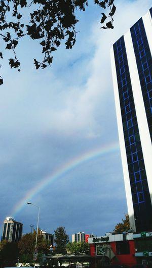 Gökkuşağı.Rainbown..🌈 Architecture Outdoors Day Cloud - Sky Social Issues No People City Nature Sky Skyscraper Tree Rainbow🌈