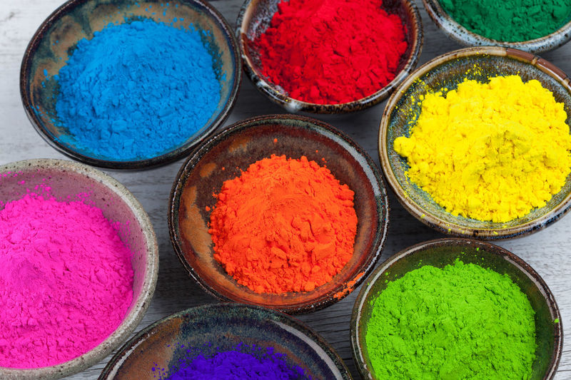 Close-up of multi colored powder paints in bowl