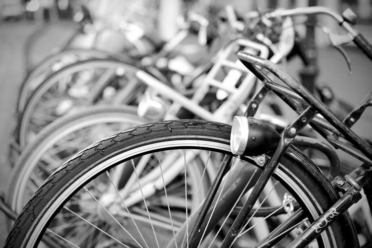 Bicycle Blackandwhite City Close-up Day Focus On Foreground High Angle View In A Row Land Vehicle Metal Mode Of Transportation No People Outdoors Parking Selective Focus Spoke Stationary Street Tire Transportation Wheel
