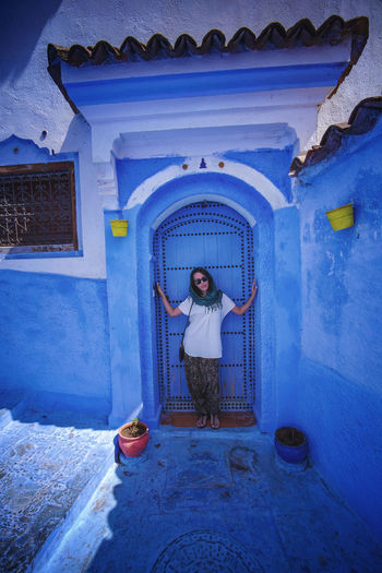"""""""The Blue City"""" - Chefchaouen, Morocco. Chefchaouen Chefchaouen Medina Chefchaouen Blue City MoroccoTrip Morocco Travel Digital Nomad EyeEmNewHere Travelling Tourist Attraction  Tourism One Person Full Length Standing Architecture Building Exterior Front View Entrance Door Built Structure Building Adult Casual Clothing Real People Day Blue Arch House Men Young Adult Outdoors"""